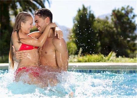 swimming pool water - Couple playing in swimming pool Stock Photo - Premium Royalty-Free, Code: 6113-06909331