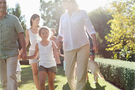 Family walking together in backyard Stock Photo - Premium Royalty-Free, Code: 6113-06909335
