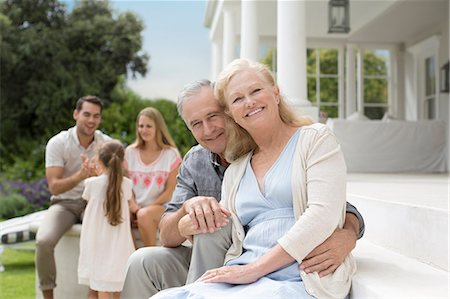 Older couple smiling on porch Stock Photo - Premium Royalty-Free, Code: 6113-06909447