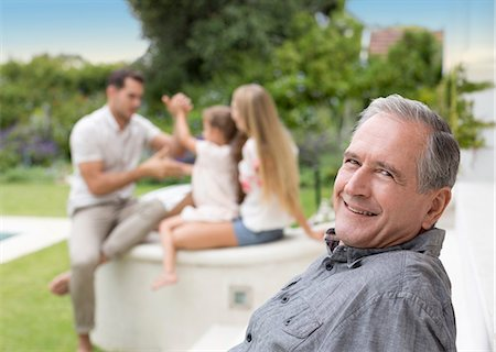 Older man smiling outdoors Stock Photo - Premium Royalty-Free, Code: 6113-06909445
