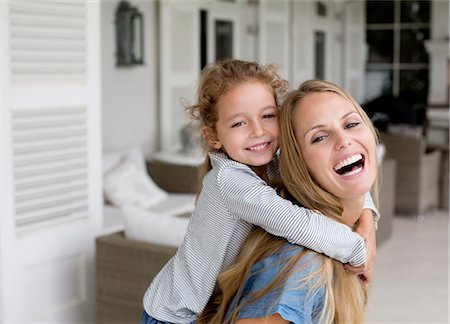 Mother and daughter playing on porch Stock Photo - Premium Royalty-Free, Code: 6113-06909450
