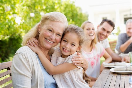 Older woman and granddaughter smiling outdoors Stock Photo - Premium Royalty-Free, Code: 6113-06909458