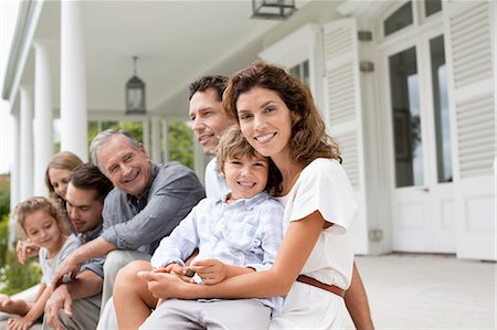 Family relaxing on porch together Stock Photo - Premium Royalty-Free, Code: 6113-06909401