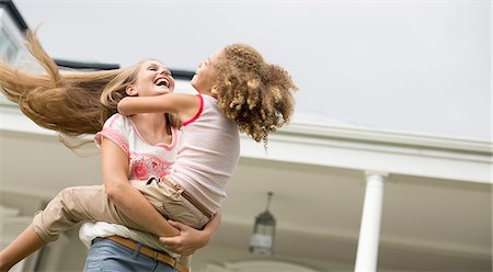 family  fun  outside - Mother and daughter playing outdoors Stock Photo - Premium Royalty-Free, Code: 6113-06909408