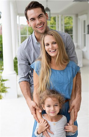 release - Family smiling together on porch Stock Photo - Premium Royalty-Free, Code: 6113-06909415