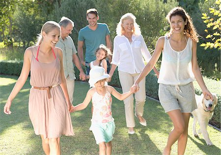 Family walking together in backyard Stock Photo - Premium Royalty-Free, Code: 6113-06909431