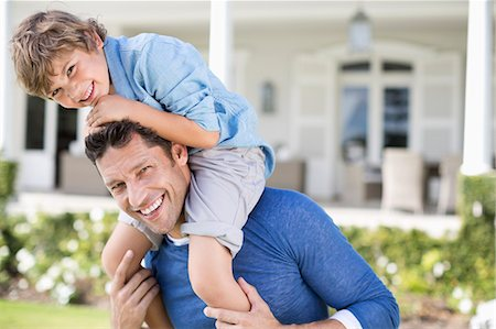 father with two sons not girls - Father and son playing outside house Stock Photo - Premium Royalty-Free, Code: 6113-06909437