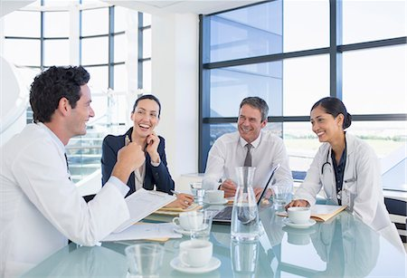 Doctors and business people talking in meeting Stock Photo - Premium Royalty-Free, Code: 6113-07146755
