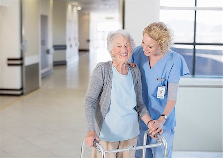 simsearch:6113-07146726,k - Nurse helping senior patient with walker in hospital corridor Stock Photo - Premium Royalty-Free, Code: 6113-07146704
