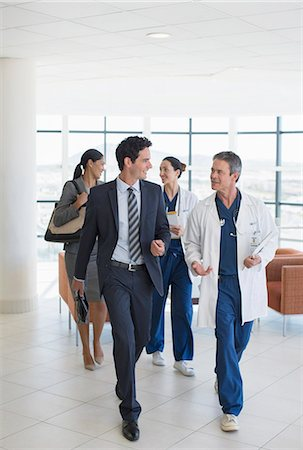 Doctors and administrators talking in hospital Stock Photo - Premium Royalty-Free, Code: 6113-07146708