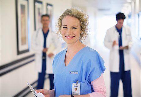 registered nurse - Portrait of smiling nurse in hospital corridor Stock Photo - Premium Royalty-Free, Code: 6113-07146712