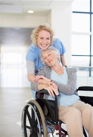 simsearch:6113-07146726,k - Portrait of smiling nurse and elderly patient in wheelchair Stock Photo - Premium Royalty-Free, Code: 6113-07146719