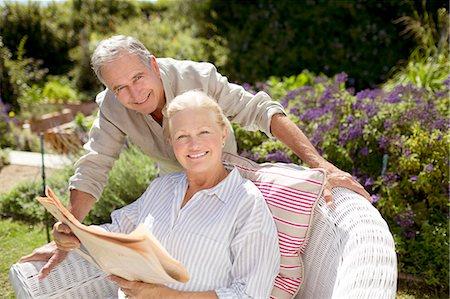 Senior couple reading newspaper in garden Stock Photo - Premium Royalty-Free, Code: 6113-07146886