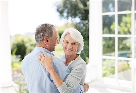 Senior couple dancing on patio Stock Photo - Premium Royalty-Free, Code: 6113-07146897