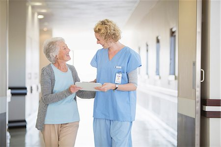 simsearch:6113-07146726,k - Nurse and senior patient talking in hospital corridor Stock Photo - Premium Royalty-Free, Code: 6113-07146808