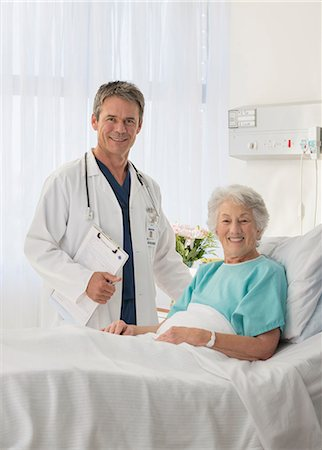 Portrait of smiling doctor and senior patient in hospital room Stock Photo - Premium Royalty-Free, Code: 6113-07146817