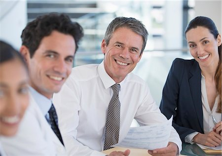 Portrait of smiling doctors and business people in meeting Stock Photo - Premium Royalty-Free, Code: 6113-07146816
