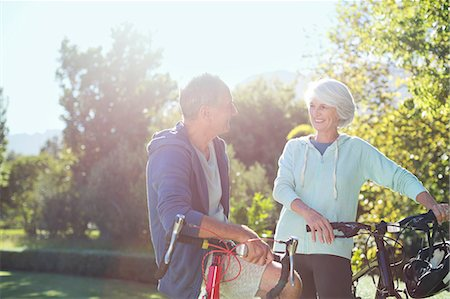 Senior couple with bicycles in park Stock Photo - Premium Royalty-Free, Code: 6113-07146821