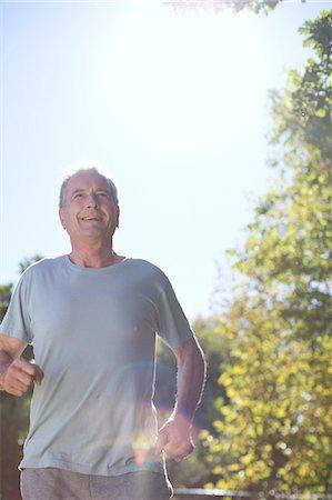 fit people - Senior man running outdoors Stock Photo - Premium Royalty-Free, Code: 6113-07146825