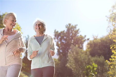 Senior women running outdoors Stock Photo - Premium Royalty-Free, Code: 6113-07146832