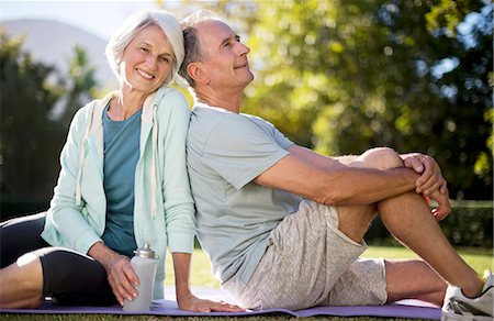 Senior couple sitting on yoga mat in park Stock Photo - Premium Royalty-Free, Code: 6113-07146911