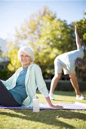 Senior couple exercising in park Stock Photo - Premium Royalty-Free, Code: 6113-07146922