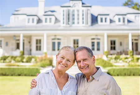 rich lifestyle - Portrait of smiling senior couple in front of house Stock Photo - Premium Royalty-Free, Code: 6113-07146938