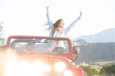 road trip - Woman cheering in sport utility vehicle Stock Photo - Premium Royalty-Free, Code: 6113-07147033