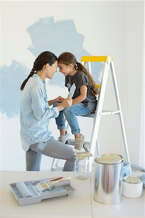 Mother and daughter painting wall blue Stock Photo - Premium Royalty-Free, Code: 6113-07147151