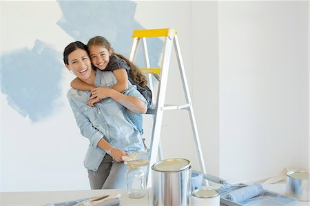 painting - Portrait of mother and daughter hugging near paint supplies Stock Photo - Premium Royalty-Free, Code: 6113-07147154