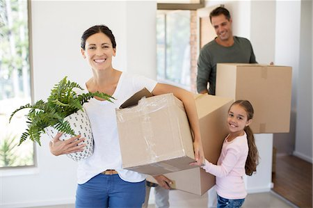 Family moving into new house Stock Photo - Premium Royalty-Free, Code: 6113-07147160