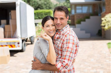 Portrait of smiling couple in front of new house Stock Photo - Premium Royalty-Free, Code: 6113-07147164
