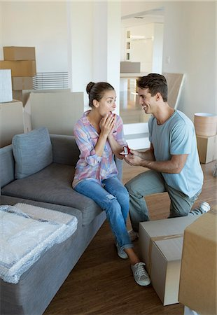 Man proposing to girlfriend in new house Stock Photo - Premium Royalty-Free, Code: 6113-07147168