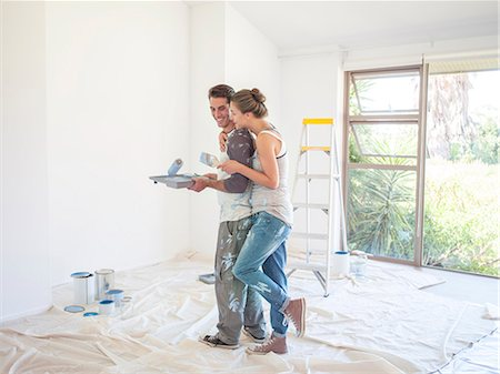 diy or home improvement - Couple painting walls Stock Photo - Premium Royalty-Free, Code: 6113-07147176