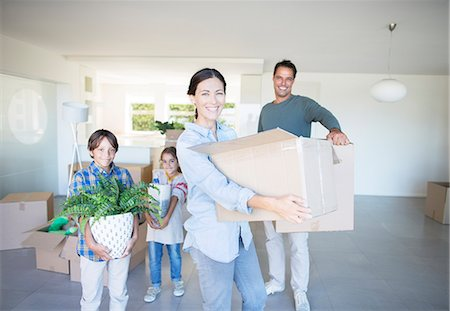 Family moving into new house Stock Photo - Premium Royalty-Free, Code: 6113-07147180