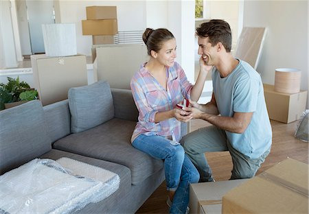 Man proposing to girlfriend in new house Stock Photo - Premium Royalty-Free, Code: 6113-07147186