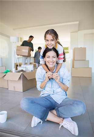 Portrait of smiling mother and daughter among cardboard boxes Stock Photo - Premium Royalty-Free, Code: 6113-07147138