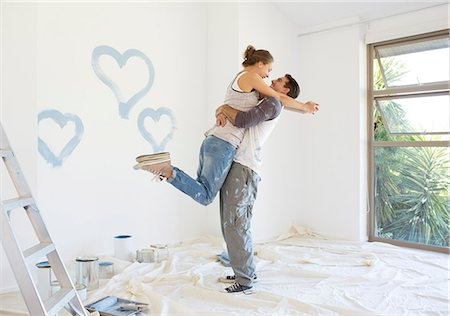 painting - Couple painting blue hearts on wall Stock Photo - Premium Royalty-Free, Code: 6113-07147246