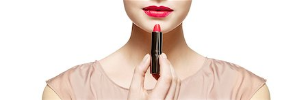 Close up of woman applying red lipstick Stock Photo - Premium Royalty-Free, Code: 6113-07147264