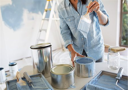 diy or home improvement - Woman holding paintbrush with blue paint Stock Photo - Premium Royalty-Free, Code: 6113-07147205