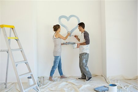 painting - Couple painting blue heart on wall Stock Photo - Premium Royalty-Free, Code: 6113-07147215
