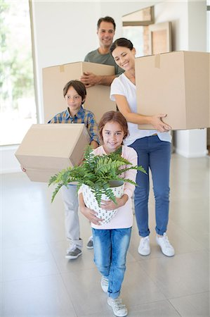Family moving into new house Stock Photo - Premium Royalty-Free, Code: 6113-07147216