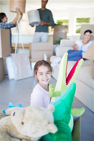 preteen girl boyfriends - Girl playing with stuffed animals in new house Stock Photo - Premium Royalty-Free, Code: 6113-07147228