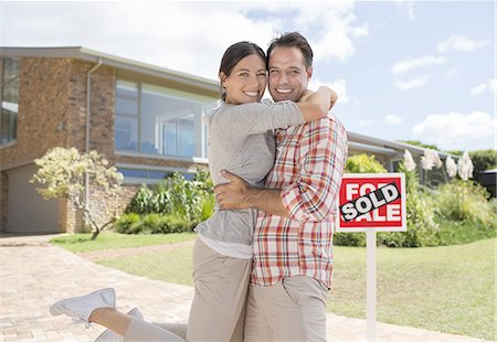 sold sign - Portrait of smiling couple hugging outside new house Stock Photo - Premium Royalty-Free, Code: 6113-07147233