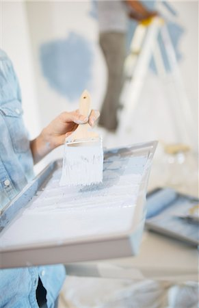 painting - Woman holding paint tray with blue paint Stock Photo - Premium Royalty-Free, Code: 6113-07147237