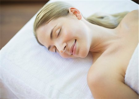 Serene woman laying on massage table Stock Photo - Premium Royalty-Free, Code: 6113-07147342