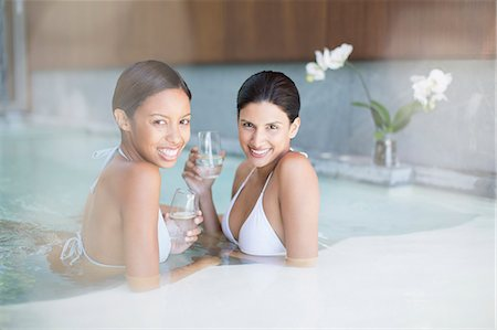 Portrait of smiling women in swimming pool at spa Stock Photo - Premium Royalty-Free, Code: 6113-07147344