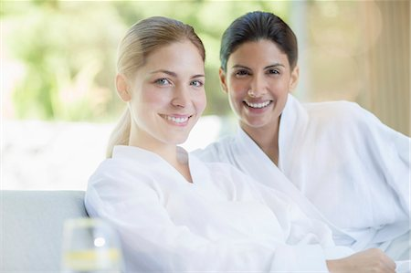 Portrait of smiling women in bathrobes at spa Stock Photo - Premium Royalty-Free, Code: 6113-07147350