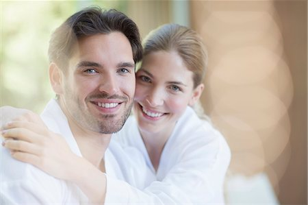 Portrait of smiling couple in bathrobes Stock Photo - Premium Royalty-Free, Code: 6113-07147355