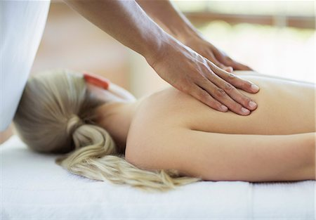self indulgence - Woman receiving massage at spa Stock Photo - Premium Royalty-Free, Code: 6113-07147356